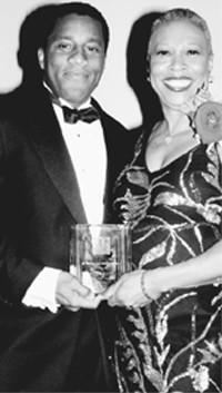 Jeffrey Tweedy, with Gloria Hartley, president of BRAG.?
