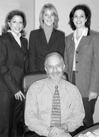 Paul Sephowitz surrounded by Jessica Hanson, Heidi Richardson and Jacqueline Singer.