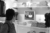 A shopper checks out the latest news at American Apparel.