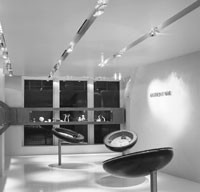 Anthony Nak's first boutique features unusual hydraulic cases that lift to become flat surfaces.
