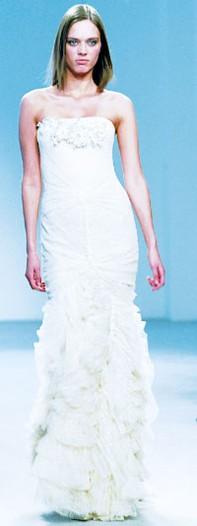 A model in the Vera Wang dress worn by Jennifer Lopez.