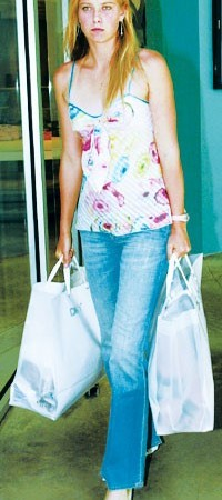 Maria Sharapova in a Diane von Furstenberg top and AG jeans emerges from the DKNY store after an afternoon shopping spree.