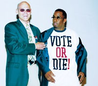 """Sean """"P. Diddy"""" Combs modeled one of Citizen Change's T-shirts, with the assistance of James Carville."""
