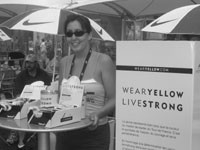 A vendor selling the Lance Armstrong Live Strong bracelets on Sunday in France.