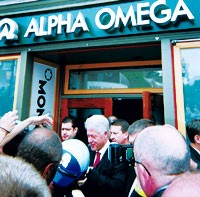 Former president Bill Clinton leaving the Alpha Omega store.