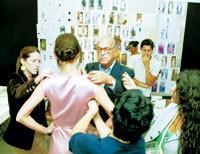 Oscar de la Renta with his design team.