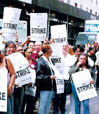 Judith Leiber workers picket on Tuesday.