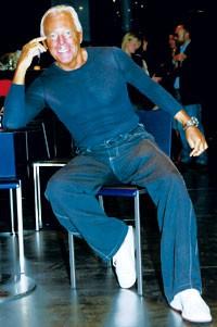 Giorgio Armani in his new jeans store.