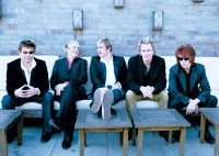 Roger Taylor, Nick Rhodes, Simon LeBon, John Taylor and Andy Taylor of Duran Duran on the roof of 60 Thompson.