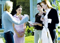 "Facing, from left, Eva Longoria, Teri Hatcher and Marcia Cross in ""Desperate Housewives."""