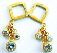 Susan Ruskin's gold and diamond earrings.