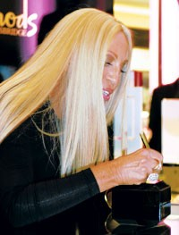 Donatella signing at Harrods.