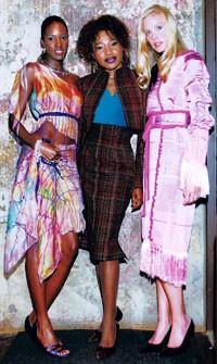 Dallas Fashion Incubator designer Elizabeth Anyaa flanked by models in her designs.