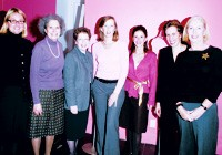The designers, center, and the women of WAR.