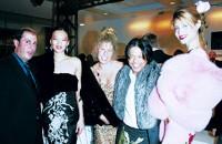 Saga Furs' Charles Ross, left, with Zang Toi and models.