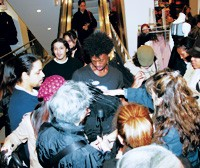 A clerk at the H&M on New York's 34th Street is mobbed as he comes down with an armful of new Lagerfeld stock.