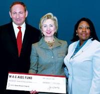 John Demsey, Sen. Clinton and Carine Jocelyn of the Haitian Women's program.