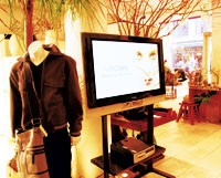 Utowa gracefully integrates plasma TVs for atmospheric effect in a relatively small selling space.