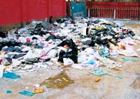 At the site of the recently razed Silk Alley, only an empty alley and a pile of garbage remains.