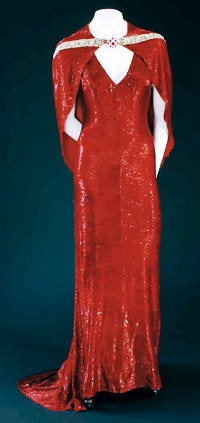 """Adrian's design for Joan Crawford in the 1937 film """"The Bride Wore Red."""""""