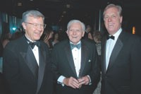 Allen Questrom and Paul Charron flank Marvin Traub at the Rainbow Room celebration.