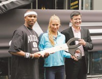 Sebastian Telfair, Anna Kournikova and Adidas ceo Herbert Hainer at the store opening fete.