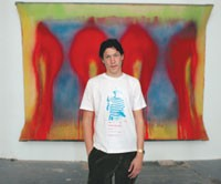 Vito Schnabel in front of one of Gorchov's paintings.
