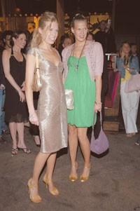 Theodora Richards in Zac Posen and Alexandra Richards in Marc Jacobs watch the burlesque.