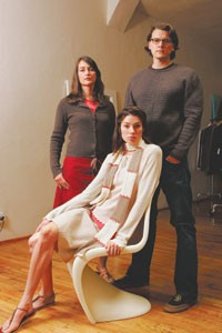 Karen Stewart and Howard Brown with a model wearing their cashmere sweater and scarf, and organic cotton canvas skirt.