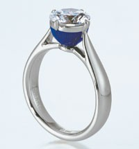 A platinum and diamond ring with blue enamel.