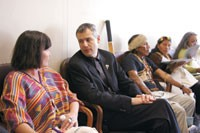 Cynthia Walker of the Navajo community, Dominique Conseil of Aveda and Moi Enomenga from Ecuador and his wife.