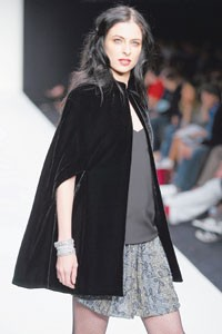 At Blue Genes, in Atlanta, retailers are merchandising slim-leg jeans with oversize capes like this one, by Jenni Kayne.