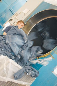 A Leontex worker removes jeans from one of the firm's machines.