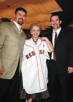 Red Sox stars Jason Varitek and Trot Nixon with Carolina Herrera.
