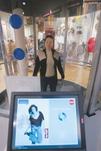 A customer gets scanned in the Intellifit booth at Levis SoHo store.