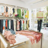 Intermix, like many smaller boutiques, tries to help the consumer coordinate outfits and accessories.