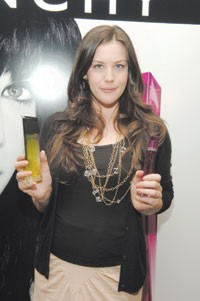 Liv Tyler touts Givenchy's new scents.