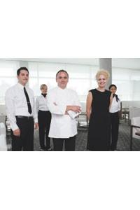 Jean-Georges Vongerichten and the staff in Calvin Klein.