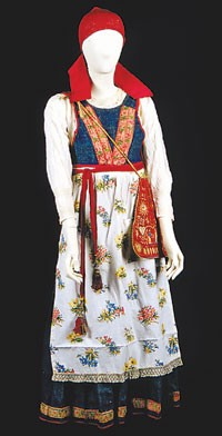 A historical peasant dress made with denim inserts shown at the Prato exhibition.