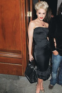 "Gwen Stefani in a L.A.M.B. dress, Christian Louboutin heels and Ralph Lauren's black croc ""Voyager"" handbag."