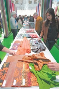 Buyers examine pelts at the Lineapelle trade show.
