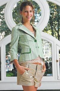 Gold metallic shorts and shrunken green blazer by Alice + Olivia.