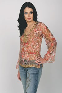 Dayanara Torres in a hand-beaded chiffon tunic and jeans.