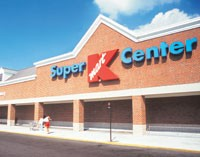 Sears Holdings Corp. is retooling Kmart. Some stores are selling Sears' more expensive private brands.