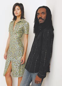 Kevan Hall with a model in a look from his spring 2006 collection.