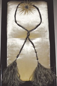 Lemarie necklace-belt with ostrich feathers and star brooch.