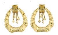 Gold and diamond earrings.