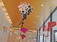 Oscar de la Renta's kite hangs with others in the lobby of 1411 Broadway, a fashion district office building.