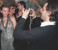Scarlett Johansson, in Calvin Klein Collection, gets her picture snapped by Marc Jacobs.