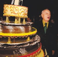 Bergé blows out his 75 candles.